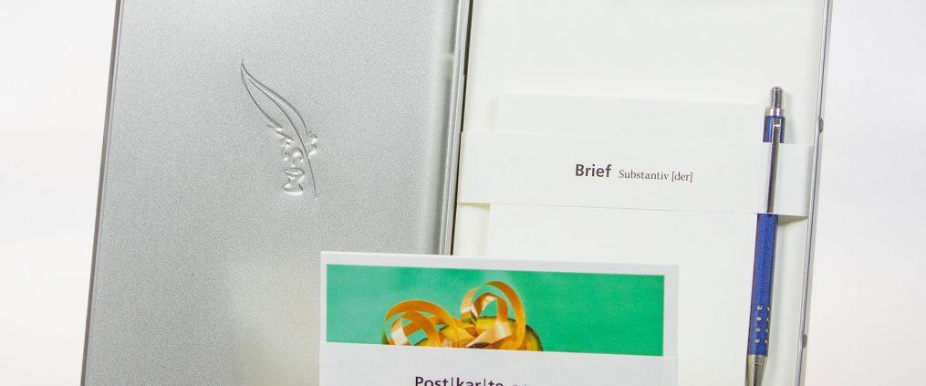 Schreibset mit Postkarten, Briefpapier, Kuverts und Kugelschreiber